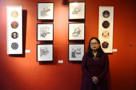 Visual Artist Sabita Dangol alongside her artworks